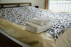Towel on bed. In bedroom Stock Photos