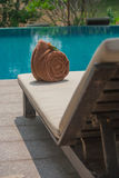 Towel on bed pool with swimming pool. Royalty Free Stock Photography