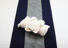 Towel on bed Royalty Free Stock Photo