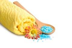 Towel, Blue bath salt and flower Royalty Free Stock Image