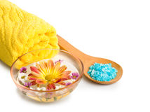 Towel, Blue bath salt and flowers in bowl Royalty Free Stock Image