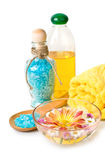 Towel, Blue bath salt and flowers in bowl Royalty Free Stock Photography
