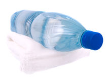 Towel and bottle of water Royalty Free Stock Photography