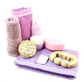 Towel, bottles and massager Stock Images