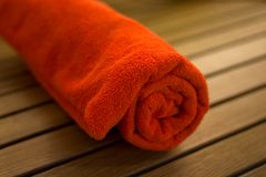 Towel braided in a tubule. Towel braided ore curtailed in a tubule on the wood chair Stock Photo