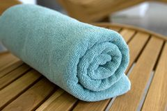 Towel braided in a tubule on chair. Towel braided ore curtailed in a tubule on the wood chair Royalty Free Stock Images