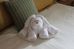 Towel Bunny. Picture of a towel bunny on the bed royalty free stock photos