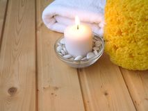 Towel, burning candle and sponge Stock Images