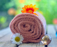 Towel candle flowers Stock Photography