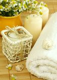 Towel, candles and camomile. Stock Image