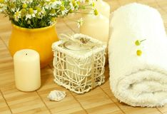 Towel, candles and camomile. Stock Photography