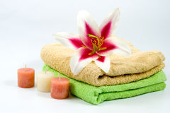 Towel, candles and flower Stock Photos