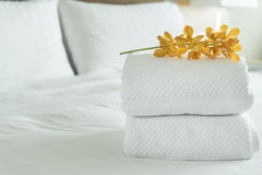 Towel. Close up, Fresh white Towel with flowers placed on the inside of the hotel room Stock Image