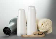 Towel, cosmetics, the hair dryer and a hairbrush Royalty Free Stock Image