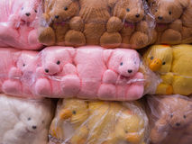Towel Doll Bears and Ducks Packed in Plastic Stock Photos