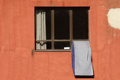 Towel drying outside window Royalty Free Stock Images