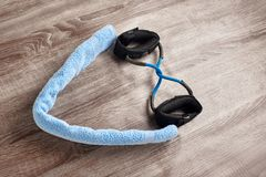 Towel and elastic expander Royalty Free Stock Image