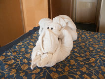 Towel elephant origami. White towel folded into an elephant on a bed Royalty Free Stock Photo