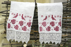 Towel with embroidery hanging on the fence Royalty Free Stock Photography