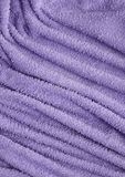 Towel fabric closeup. Closeup detail of a purple towel Royalty Free Stock Image