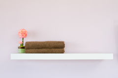Towel fake flowers. In room Stock Images