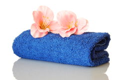 Towel and flower Stock Images