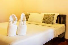 Towel flower in bedroom hotel Royalty Free Stock Image