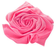 Towel in flower shape isolated on white background. Pink waffle towel folded in the shape of a rose on a white background Royalty Free Stock Photo
