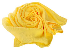 Towel in flower shape isolated on white background. Yellow waffle towel folded in the shape of roses on white background Stock Photo