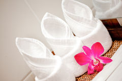 Towel with flower in spa concept. At resort Royalty Free Stock Image