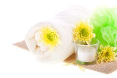 Towel, flowers, candle and bamboo mat Royalty Free Stock Photos