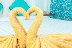 Towel folded in swan heart shape. On bed Royalty Free Stock Photo