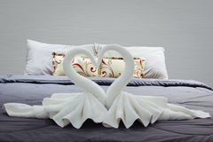 Towel folded in swan shape on bed sheet Royalty Free Stock Photography