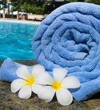 Towel and frangipani flowers Stock Photo
