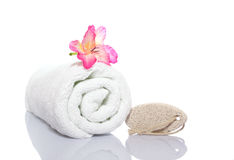 Towel, gladiola and pumice Stock Photography
