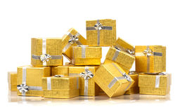 Towel of gold gift boxes Stock Photos