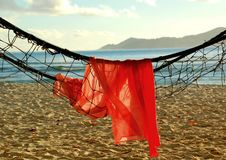 Towel and hammock on beach Stock Image