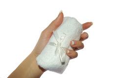 Towel in hand. On white royalty free stock image