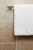 Towel on a hanger. Clean white towel on a hanger Stock Image