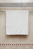 Towel on a hanger. Pure white towel on a hanger Royalty Free Stock Photo