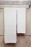 Towel on a hanger. Pure white towel on a hanger Royalty Free Stock Image