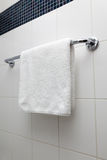 Towel on a hanger. Clean white towel on a hanger Royalty Free Stock Photography