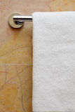 Towel on a hanger. Clean white towel on a hanger Royalty Free Stock Image
