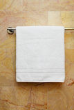 Towel on a hanger. Clean white towel on a hanger Stock Photography