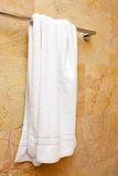 Towel on a hanger. Clean white towel on a hanger Stock Photo