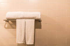 Towel on a hanger. In the bathroom Stock Images