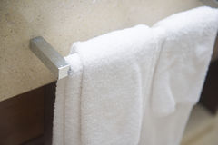 Towel on the hanger in the bathroom. Clean Stock Images