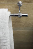 Towel on a hanger. Clean white towel on a hanger, marble Royalty Free Stock Photography