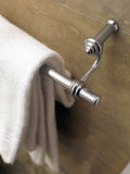 Towel on a hanger. Clean white towel on a hanger, marble Royalty Free Stock Photo