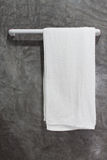 Towel on a hanger with concrete Wall Royalty Free Stock Image